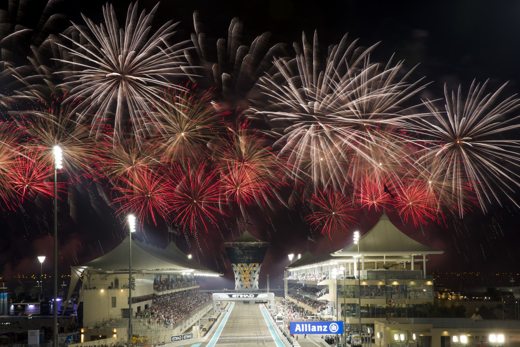 A photograph of the sky filled with colourful fireworks at the end of race day with the finish line and Shams Tower in the distance. Formula 1 Etihad Airways Abu Dhabi Grand Prix. Yas Marina Circuit, 29th November 2015. United Arab Emirates.