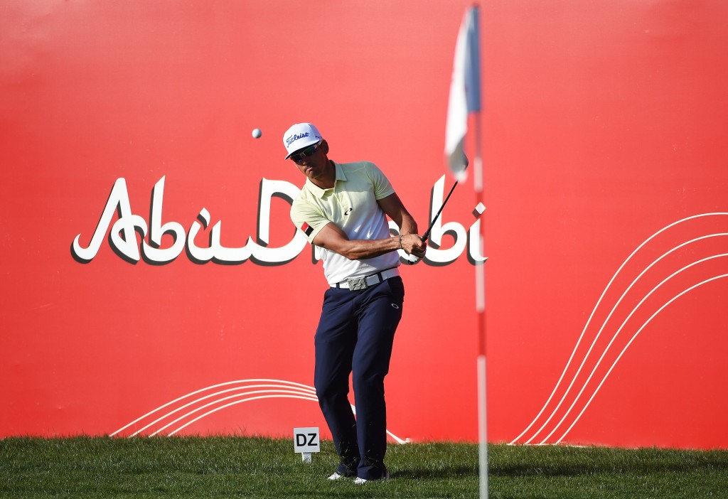 ABU DHABI, UNITED ARAB EMIRATES - JANUARY 24:  Rafa Cabrera-Bello of Spain chips on to the 17th green during round four of the Abu Dhabi HSBC Golf Championship at the Abu Dhabi Golf Club on January 24, 2016 in Abu Dhabi, United Arab Emirates.  (Photo by Ross Kinnaird/Getty Images)